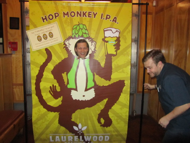 Taplister's Kerry Finsand is the Hop Monkey. Laurelwood's Micah Bell has a laugh.