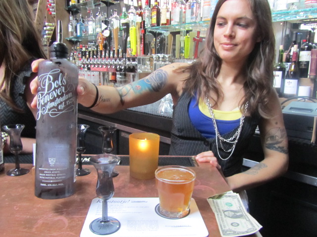 Bartender at Circa 33 serves Bol Genever Dutch gin with Upright Kopstootje back