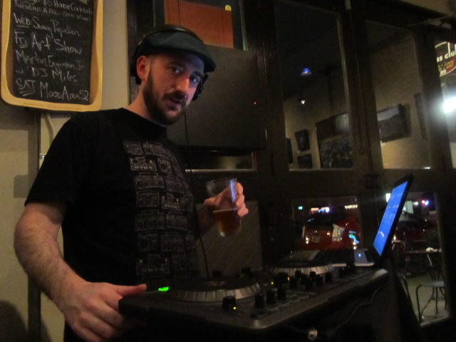 """Brewpublic co-founder Aaron """"DJ Miracle"""" Miles playing music at the Press Club"""