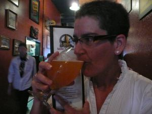 Ginger Johnson enjoying a glass of craft/beer