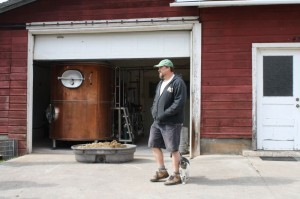 Logsdon Farmhouse brewer Charles Porter with celebrity farm cat Petey