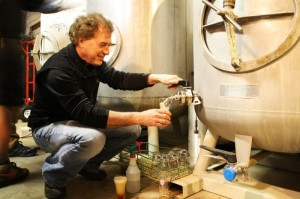 Dave Logsdon of Logsdon Farmhouse Ales pours his Seizoen from the zwickel