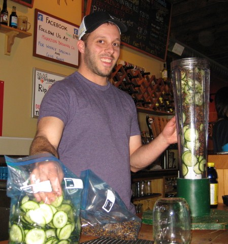 Breakside Brewery's Ben Edmunds loads a randall with cucumbers and juniper berries