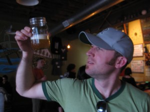 Brewpublican Dan Culver inspects a pour of Breakside's Rye Kolsch run through a fruit randall