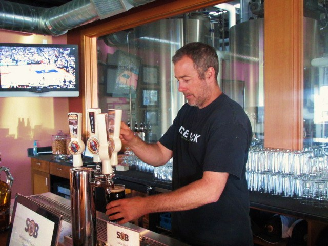 Southern Oregon Brewing brewmaster Scott Saulsbury pours samples at SOB's tasting room