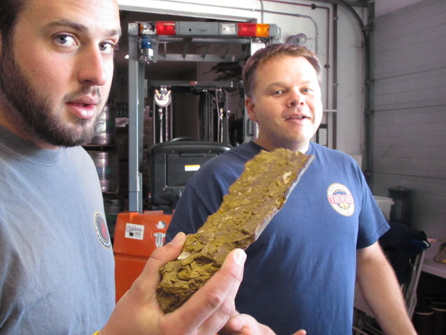 Oakshire's Brian Coombs holds a piece of hop hash beside Caldera brewer Adam Benson