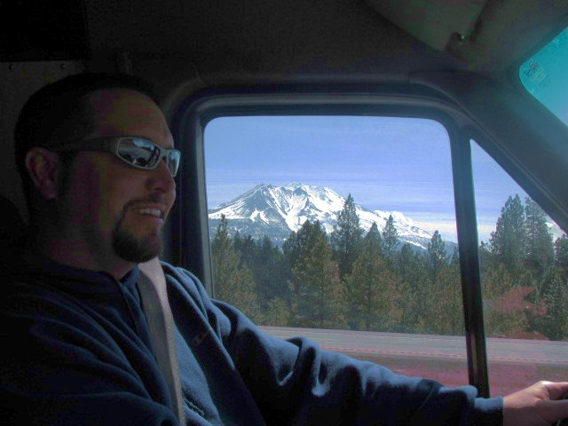 Oakshire's Matt Van Wyk driving with Mt. Shasta in the distance