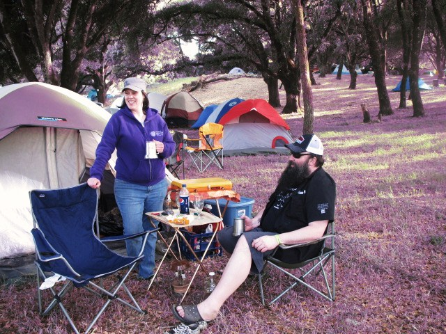 "Amy Welch and Chris ""King C"" Ensign enjoy a nice camp site under the oaks at Anderson Valley Brewing"