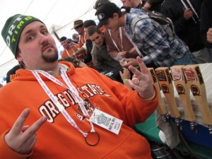 Theo Skourtist pours beer at Boonville Beer Fest