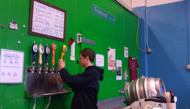 Casey Gish pours brews for patrons at Seattle's Fremont Brewing