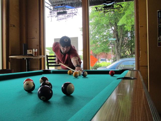 Mario De Ieso shoots billards at Blitz Ladd Sports Bar