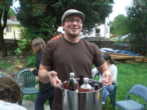 Cascade brewer Sean White with a bucket o summer brews