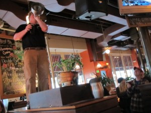 Portland Rock Bottom Brewmaster Charlie Hutchins address the crowd while brewer Bolt Minister looks on