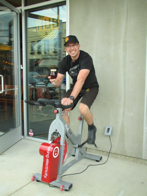 Hopworks Brewmaster/founder Christian Ettinger powers the pub with a pint of Galactic Imperial Red at HUB Bike Bar