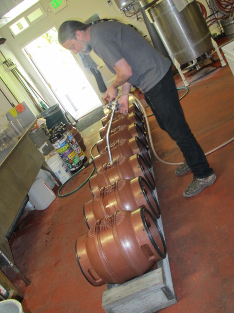 Brewmaster Ted Sobel fills the casks with Rye IPA
