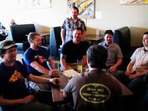 Ezra Johnson-Greenough (top center) leads a tasting preview of the Portland Fruit Beer Festival at Burnside Brewery