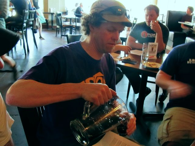Fort George's Jack Harris pours a sample of his brewery's Badda Boom! Cherry Stout