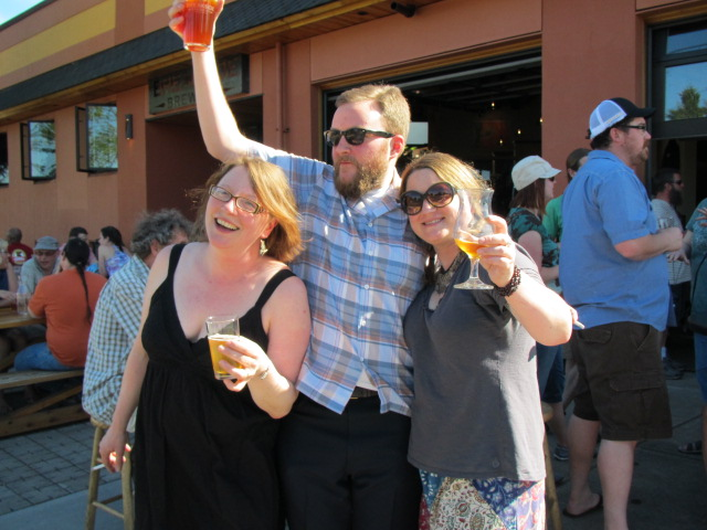 "Saraveza staff enjoy the bounty of their labor at Breakside Collaboration Fest (L to R) Kate Vincent, Tyler ""The Elder"" Vickers, and Erika Huston"