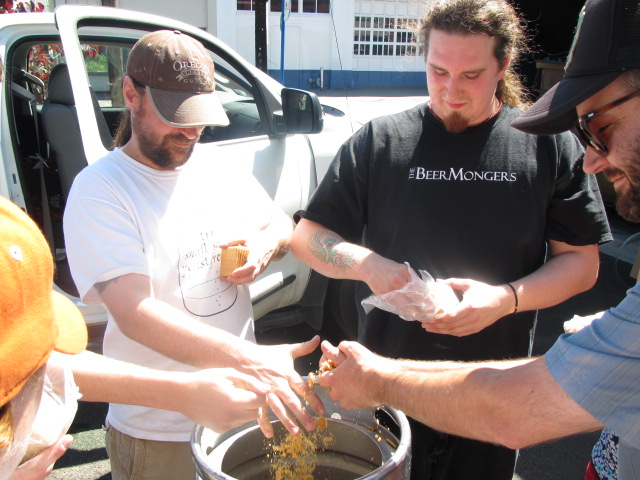 Portland U-Brewers Jason Webb (left) and Aaron Gillham add crushed graham crackers to their S'more Beer