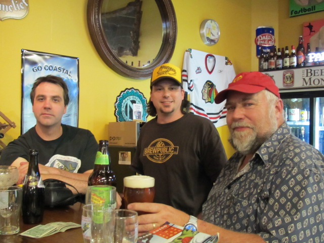 BeerMongers Craig Gulla (left) and Sean Campbell (center) with John Foyston