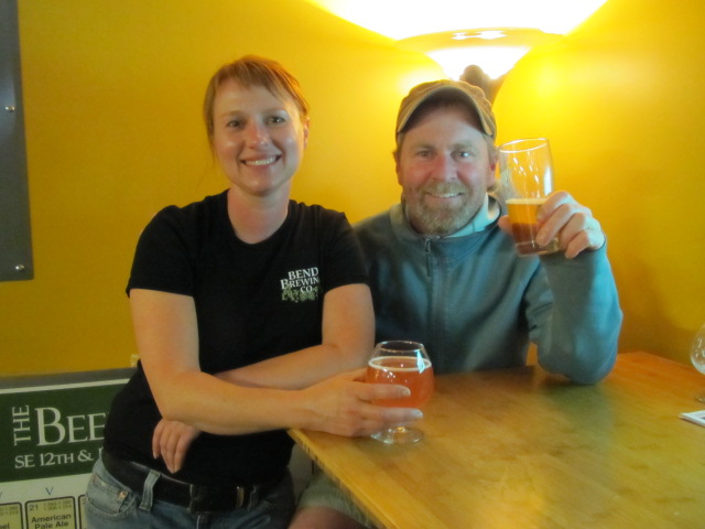 Bend Brewing's Tonya Cornett (left) and Lompoc's Dave Fleming enjoy a brew at Bend Beer Night at The BeerMongers