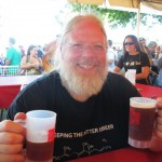 Full Sail Brewmaster John Harris with mugs of 1995 Old Boardhead Barleywine