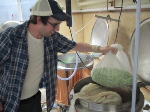 Brewpublic's Angelo De Ieso adds hops he grew to the kettle at Portland U-Brew