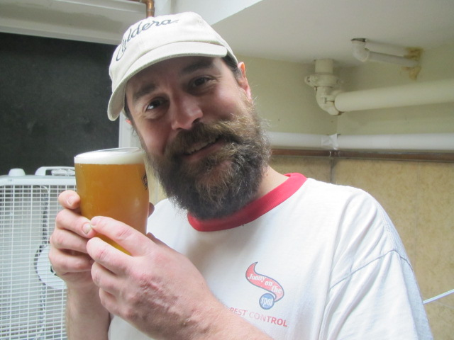 Jason Webb, brewmaster at Portland U-Brew with a pint of ReFresh Hop Bloggerbrau