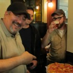 Dave Nunez of By The Bottle (left), Mike Wright of The Commons Brewery (center), and Sean Burke of The Commons Brewery at Great Divide with pizza