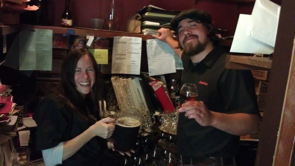 Saraveza founder Sarah Pederson (left) and bar manager Johnathan Carmean serve up Russian River Consecration to toast with patrons for Saraveza's 3rd Anniversary party