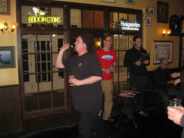 Aaron Gillham tosses a dart at the Horse Brass Pub to determine Portland U-Brew's beer style for 2012 Portland Cheers to Belgian Beer