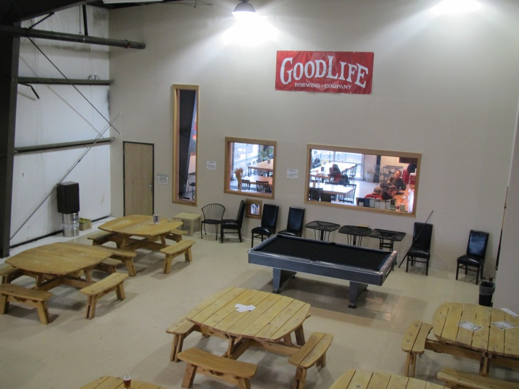 Indoor brewwery seating and pool table at GoodLife Brewing in Bend, OR