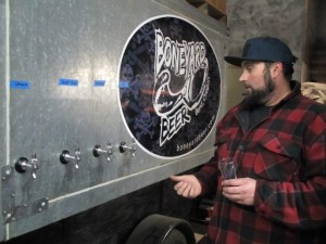 Boneyard co-founder Clay Storey at the taps