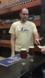 Josh Grgas works the bar at The Commons Brewery