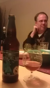 #pdxbeergeek Michael Umphress and a bottle of 2010 Ninkasi Critical Hit Barleywine