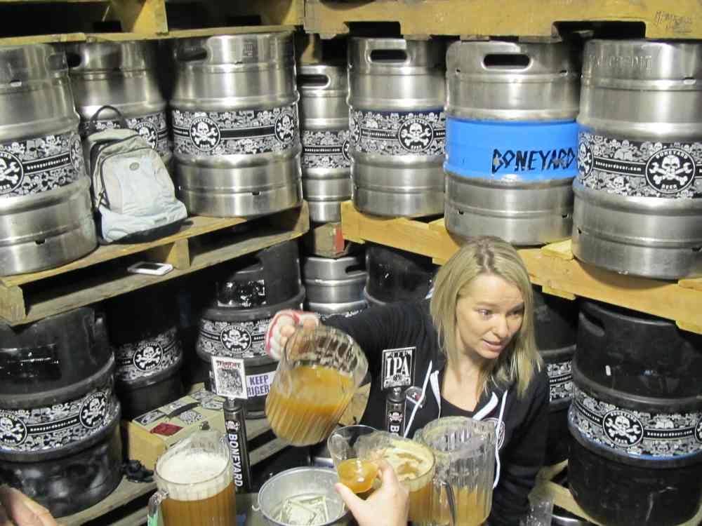 Melodee Storey of Boneyard Beer pouring samples of brite beers for Zwickelmania 2012