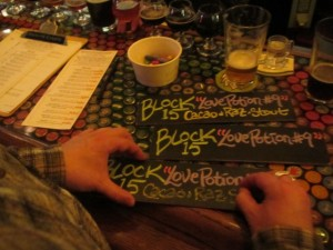 Saraveza's Jonathan Carmean prepares beer signage for My Beery Valentine 3