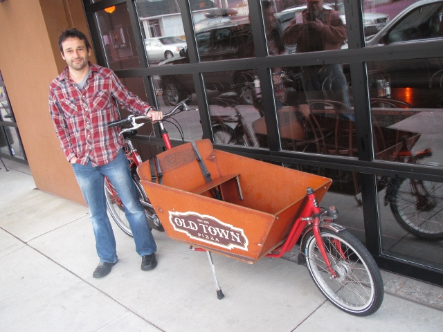 Old Town Pizza proprietor Adam Milne with one of his delivery bicycles