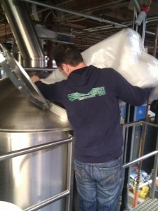 Jamie Floyd of Ninkasi Brewing helping to brew the 2012 Sasquatch Legacy beer to debut during Eugene Beer Week (photo by Jason Carriere)