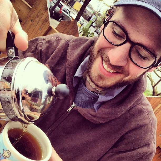 Angelo pouring some Yerba Mate at Mint Tea