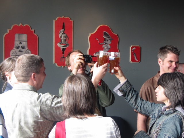 An inaugural toast by patrons at Gigantic Brewing's opening day