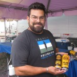 Hopworks Urban Brewery's Jaime Rodriguez shows off the new canned brews at 2012 NAOBF