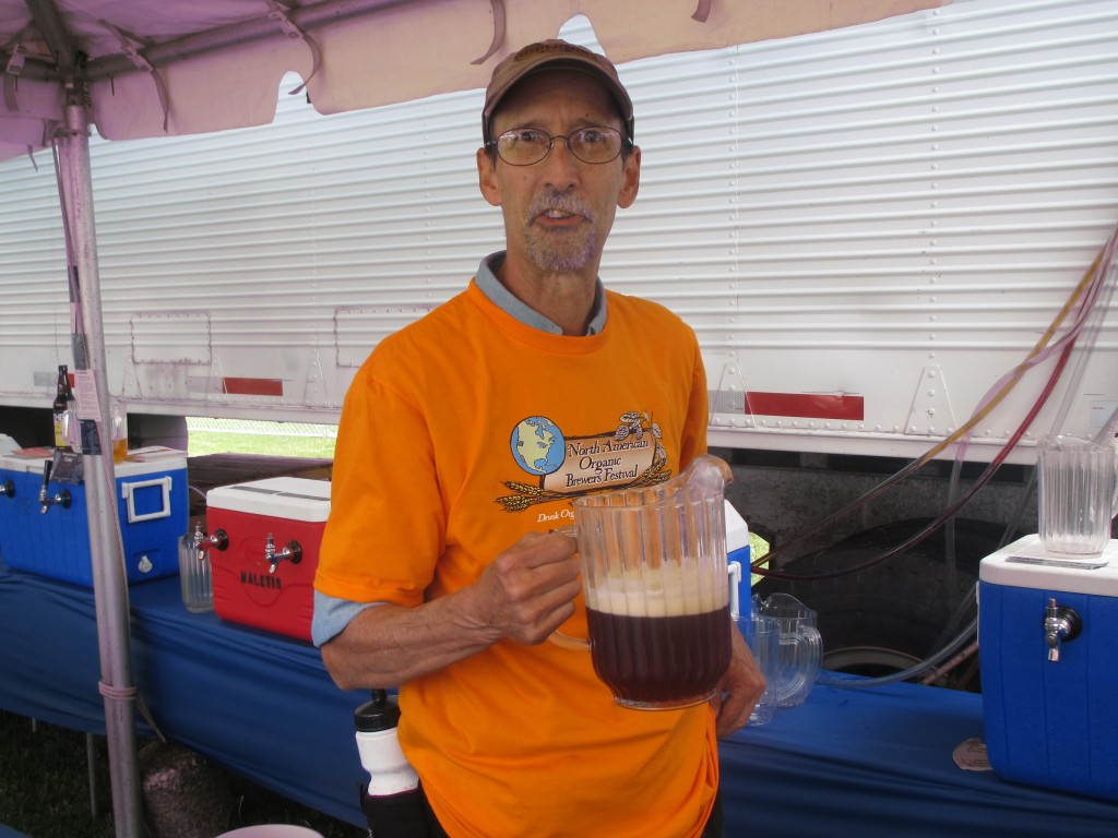 Volunteer server Don Gilson with a pitcher of Laurelwood Deranger Organic Imperial Red at the 2012 North American Organic Brewers Fest (NAOBF)