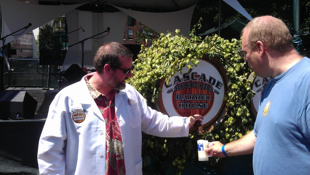 Curtis Bain of Cascade Brewing pours mugs of Summer Gose from the barrel