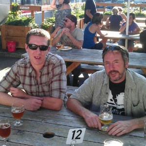 Double Mountain brewers Kyle Larsen (left) and Matt Swihart enjoy beers at APEX