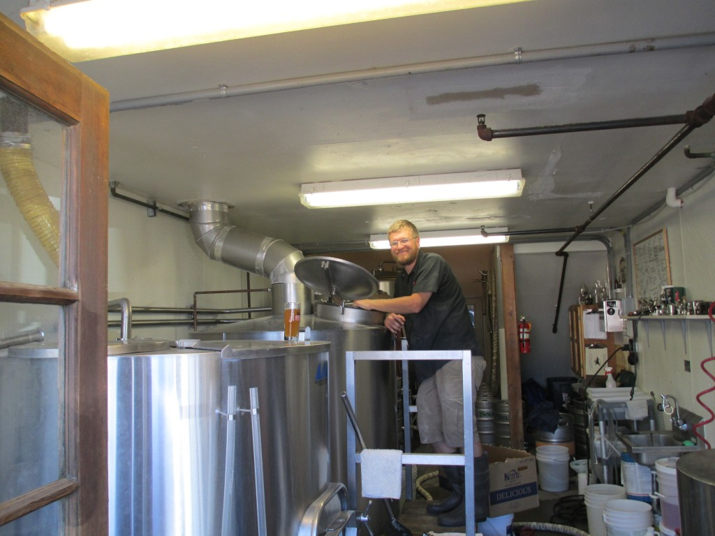 Solera Brewmaster Jason Kahler making a fresh hop Imperial IPA in the brewhouse (photo by Terry Metcalf)