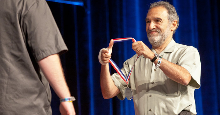 Charlie Papazian awards a medal at GABF (photo courtesy of the Brewers Association)