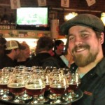 Jonathan Carmean with a tray of Russian River Consecration for Saraveza's 4th Anniversary toast