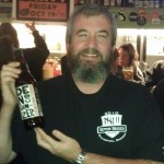 Chris Milner aka Dr. Sci with a bottle of Drake's Denogginizer IPA