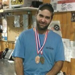 Laurelwood brewmaster Vasilios Gletsos shows off his latest hardware from GABF